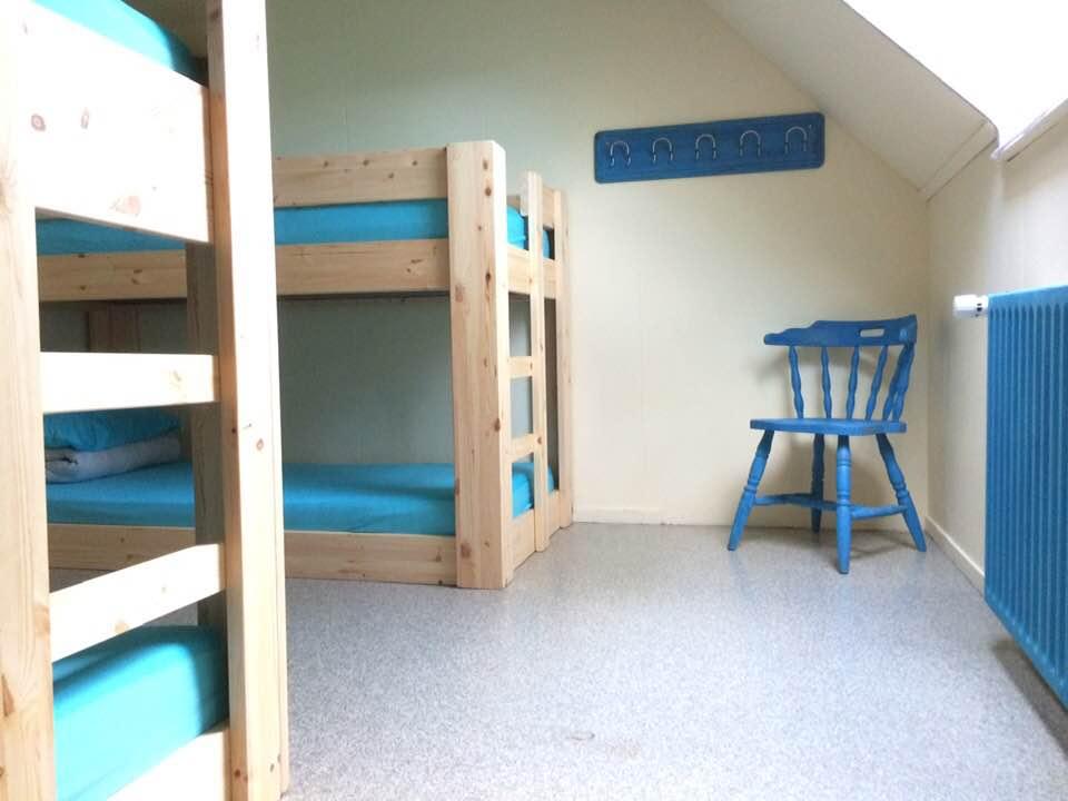 blauwe kamer met stoel
