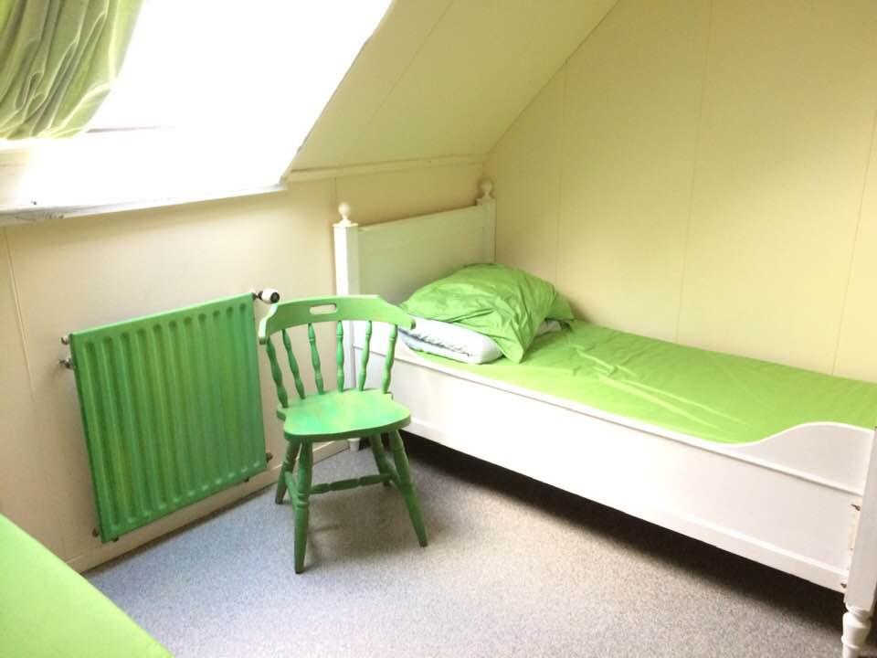 groene kamer met stoel